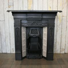 Original antique Victorian cast iron fireplace with tiles at thearchitecturalforum.com  -browse our huge selection online or in-store