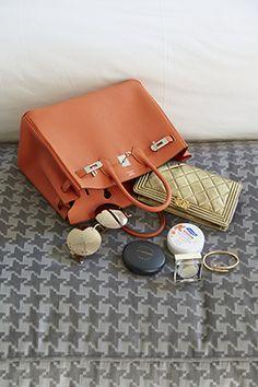 dd3f62be0cd0 Inside Roxy s Hermes Birkin Bag - a golden Chanel wallet