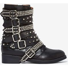 Forget pink, let's get pretty in punk. The Cruzados Boot has a black leather shell and features adjustable strap detailing, stud and buckle hardware, lace-up d…