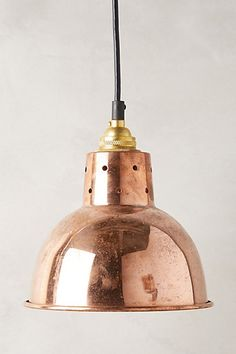 Copper Pendant Lamp from anthropologie.com. A great design for industrial, rustic or contemporary interiors.