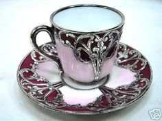 STERLING SILVER Overlay CUP AND SAUCER ON PORCELAIN This is very thick silver overlay which has been hand engraved to decorate it. The interior of the cup and underside is a pure white as you can see