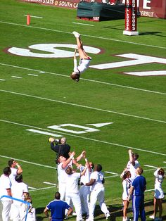 Ole Miss  CHEER , college cheerleading, in the air, stunt, cheerleader, collegiate - Head over Heels Mississippi State cheerleading, cheerleaders m.19.132 moved from @Kythoni Cheerleading: Collegiate board http://pinterest.com/kythoni/cheerleading-collegiate/ #KyFun