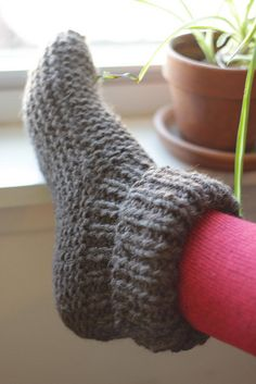 knitted slippers - toasty-looking..MADE A PAIR FOR HUBBY IN CHUNKY WOOL AND HE LOVES THEM