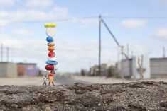 Balancing+Act Miniature Street Art with the Little People.  (i would call it the borrowers on pharmaceuticals)