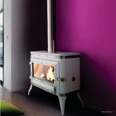 This playful freestanding fireplace available in white, red or black enamelled cast iron, and also charcoal raw finish, re-interprets the humble wood stove found in . Wood Burning Logs, Loft Living, White Wood, Wood, Stove, Freestanding Fireplace, Cast Iron Fireplace, Modern Fireplace, Wood Stove