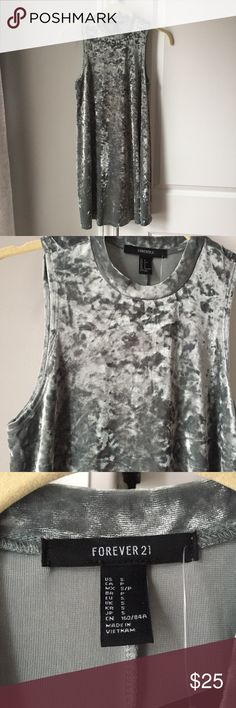 NWT sage velvet midi tank top dress NWT sage velvet midi tank top dress. It's kind of a grayish color. Very comfy. Longer dress. I'm 5'5 and it went to my knees. Cute with a black bomber jacket. Fits xs/s well. More flowy if you are a smaller size. Never worn. Forever 21 Dresses Midi