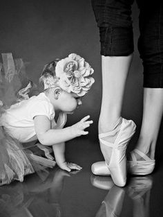 I remember being super young like this and being fascinated by the big girls pointe shoes. Hehe :) just like this.