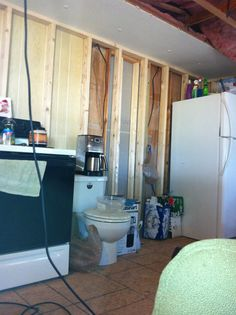 we used this area as our kitchen for about a year. Formerly 2nd bdrm, soon to be our living room