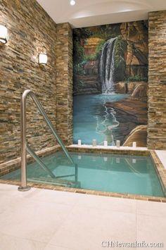 Mikvah ritual bath with waterfall stone mosaic mural.