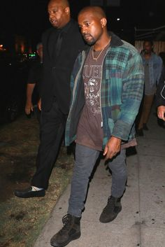 Kanye West wearing Acne Studios Ace Used Cash Slim-Fit Jeans and Yeezy Season 3 Lace-Up Boots