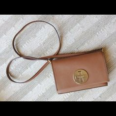 Kate Spade cross body Kate Spade cross body in tan color. The lock is scratched a little but not noticeable in distance. No damages. Still have tons of life. kate spade Bags Crossbody Bags