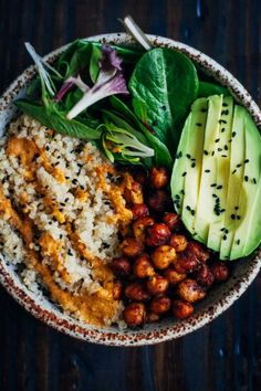 Vegan Buddha Bowls: Consists of Organic Quinoa, Chicpeas, Organic Salad-Spinach, Raddichio and Black Sesame seeds on top of Avocado