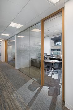 Office at BGC Engineering - office interior design by SSDG Interiors Inc. - wood office door, glass partition, natural light, workspace,  modern office design