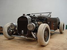 """Hot Rod """"Salt & Pepper""""   2008 scrap metal, welded, with various applications (leather, rubber, glass) length 55cm"""