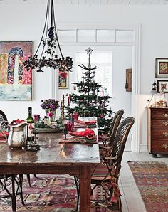 beautiful dining room: love the tree; chandelier; table + table setting