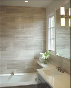 Use warm white to break up all the brown in the bathroom