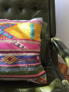 "vintage turkish wool kilim pillow with new cotton backing and zipper closure. pink, yellow, blues, and well look at all the colors! new poly-fill insert included. 16"" x 16"" totally trying not to keep"