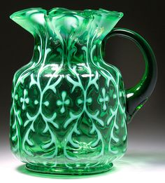 Opaline Brocade/Spanish Lace green water pitcher by Northwood Glass Co., circa 1900. Price realized: $1,495. Jeffrey S. Evans & Associates image.