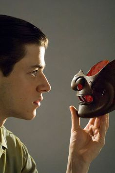 Hannibal Rising - 2007 (Gaspard Ulliel) Hannibal analyzing a samurai mask symilar to the his well known mouth guard mask. This picture looks like as if he was looking into the future. Hannibal Lecter, Hannibal 2001, Hannibal Rising, Werewolf Name, Scary Movies, Terror Movies, Gaspard Ulliel, Sir Anthony Hopkins, Greatest Villains