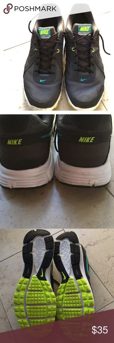 Nike Tennis shoes Nike Revolution 2 running shoe. Wore twice but not as a running shoe. Label says size 11, but can fit 10 also. I am a ten and they were comfy. Excellent condition. Nike Shoes Sneakers
