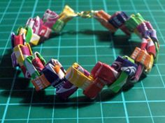 candy wrapper bracelet, maybe with the coffee bags i have been saving!