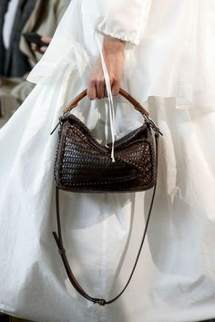 Details at Loewe RTW Spring I love the contrast of color and material with the white ethereal garment and the dark, tough leather handbag. Spring Fashion Outfits, Fashion Bags, Women's Fashion, Fashion Shoot, Ladies Fashion, Fashion Trends, Puzzle Bag, Loewe Puzzle, Loewe Bag