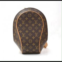 Louis Vuitton Monogram Leather Ellipse Backpack This Louie was one of my very first Louie Vuitton's that I've owned. I actually picked up when I was traveling in Paris! The straps have turned to the dark leather brown, but all the hardware is still in perfect condition! Needs a new home and it still has tons of life left! Louis Vuitton Bags Backpacks