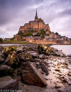 Mont Saint Michel, France.  Mont Sain Michel is one of the most visited places in France. It is a rocky island connected to the mainland via a tidal caseway which is covered at high tide and revealed at low tide.