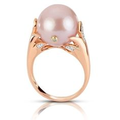 Windsor Pearl 14K Rose Gold Ring  It is not often that a piece of jewelry takes our breath away but this brand new design from our Windsor collection has left us speechless! The way that the soft blush color of the 14K rose gold compliments the natural pink color of this large 13-14mm pearl is truly a match made in heaven!  SPECS: 20 diamonds for a total carat weight of .056 including one diamond actually drilled and bezel set into the surface of the pearl, 13-14mm natural colored bead…