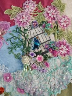 Crazy quilt with buttons, lace, beading, silk ribbon flowers, motifs and ornate embroidery stitching.