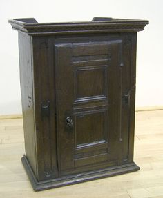 English oak hanging cabinet, early/mid 18th c., with single paneled door flanked by recess carved pilasters