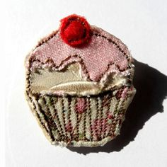 Leather cupcake brooch.