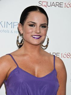 JoJo is wearing metallic purple lipstick and bronze metallic eyeshadow