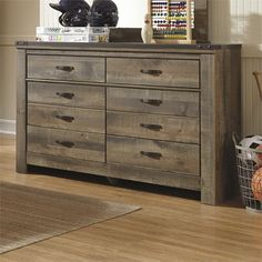 Lowest price online on all Ashley Trinell 6 Drawer Wood Double Dresser in Brown - B446-21