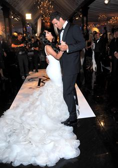 Kim Kardashian tied the knot with New Jersey Nets player Kris Humphries on August 20th, 2011. She wore a second Vera Wang gown for the first dance. The figure flattering mermaid featured a dramatic train of organza petals, and is a version of the Vera Wang Holly gown. Vera Wang gowns are sold at The Bridal Salon at Saks Jandel.