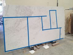 picking our cuts in our slab for our white marble kitchen bench