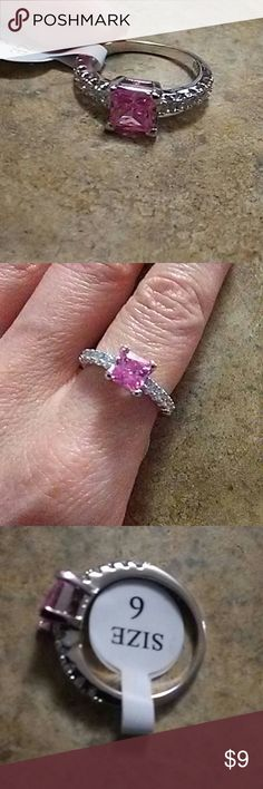 💫🆕BNWT STERLING AND CZ PINK PRINCESS CUT RING ⭐BRAND NEW WITH TAGS IN A CLEAR BOX  ⭐SIZE 6  ⭐FAUX CZ STONES SURROUND A PINK PRINCESS CUT STONE  ⭐AWESOME STOCKING STUFFER ⭐PLEASE REMEMBER THIS IS COSTUME JEWELRY AND PRICE REFLECTS SUCH ⭐BUNDLE, SAVE, MAKE OFFERS!! Jewelry Rings