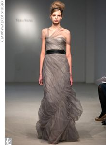 Gray mermaid dress with a smocked skirt and an illusion neckline by Vera Wang.