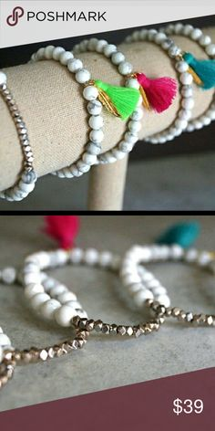 Gemstone Tassel Bracelets Tassel Bracelets feature silver plated faceted nugget beads surrounded by white turquoise beads. Finished with signature gold feather. These stretch bracelets are made to fit most wrists. Function & Fringe Jewelry Bracelets