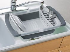 prepworks collapsible over-the-sink dish drainer... Great if you have not counter space.