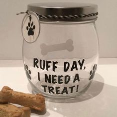 Leave your dog's treats out in this handy, great looking treat jar. This round glass canister has a twist-on shiny metal cover to keep treats fresh. Ruff Day, I Need a Treat! in vinyl on the front and comes with matching dog paw print tag attached. Dog Treat Container, Dog Treat Jar, Dog Training Methods, Basic Dog Training, Training Dogs, Positive Dog Training, Pots, Easiest Dogs To Train, Diy Dog Treats