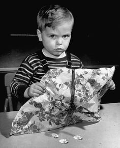 Vintage Christmas Photograph ~ All Done!! Little Boy with his Wrapped Christmas Present all Covered in Santa Stickers. 1942