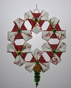 A Christmas Wreath using the origami technique with stiffened fabric. Pretty neat.