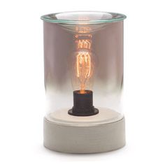 Parlor Lightbulb Scentsy Warmer  Infuse your space with the romantic glow of an Edison bulb. Smoky gray glass and a cement base add to the vintage ambiance.  Each Scentsy warmer is supplied with a 3 year guarantee (excluding lightbulb) complete with a power lead.  This warmer is supplied with one Edison bulb (replacement bulbs can be purchased separately).