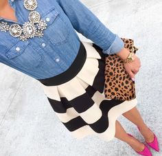 Cute outfit! Blue jean shirt matched with a black and white flare skirt, pink heels and a wonderful neckless.