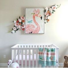 Pretty pink nursery for baby. Peep the flamingo!   @ chandeliers.and.champagne