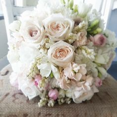 We love everything about this lush and romantic bouquet from #AmborellaFloralStudio in shades of cream and blush pink. #WeddingFlowers #WeddingBistroFave