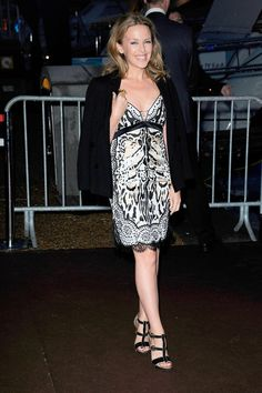 Cannes Roberto Cavalli yacht party - May 22 2013: Kylie Minogue in a Roberto Cavalli leopard-print slip dress.