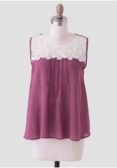 <p>Rendered in the perfect color to transition from season to season, this rich mauve-hued top is decorated with a sheer white crochet panel at the front yoke. Designed with pintuck details at the front for added interest and a back keyhole with button closure, this darling blouse styles well with a midi skirt and flats for a romantic-inspired look. Sheer.</p> <p>100% Polyester<br /> Made in USA<br /> 35.5