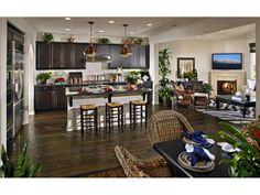 dark wood floors, white trim & dark kitchen cabinets